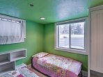 Kids can have their own unique space in this vibrant fourth bedroom.