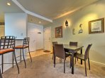 Serve your culinary creations at the 2-person breakfast bar or the dining room table!