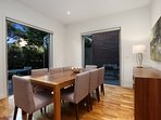 6 - Kew luxury home - spacious dining room opening on to Alfresco area & cafe setting