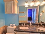 3rd floor-blue room's bathroom with walk-in shower and double sink, granite counter top.