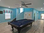 a custom built billiard table in the game room will be a bonus amenity while you are vacationing