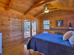 The master bedroom offers a plush queen bed.