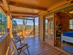 The cozy cabin offers ample outdoor space, from the covered front and back porch, to the patio - all with beautiful...