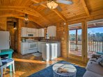 Inside, the log cabin features an open floor plan combining the living area, dining space and kitchen.