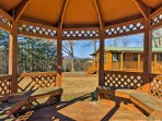 Sip a glass of wine while chatting with your travel companion in the gazebo.