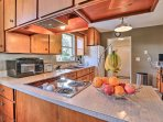 The kitchen comes fully equipped to handle all of your cooking needs.