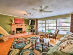 The living room features a flat-screen cable TV and wood-burning fireplace.
