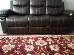 Recylining loveseat sofas in home