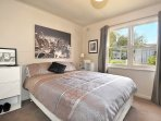 Second bedroom with queen size bed overlooks the lovely rear garden