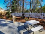 We also have a kids' picnic table and giant falling timbers game in the fenced backyard.