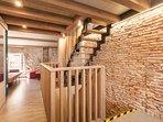 Casa Amando - penthouse - stairway & original brick wall