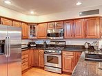 Large updated kitchen with gas stove and stainless steel appliances