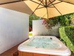 Hot tub with adjustable umbrella