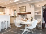 Open plan kitchen-diner lends a great sociable atmosphere. Cook and chat with friends over the bar.