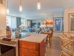 Open concept kitchen which creates a bright and airy ambience.