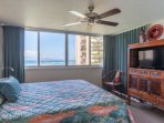 Ocean views form the bedroom with king sized bed and flat screen television.