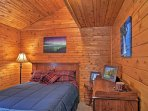 You'll find a second queen bed in this bedroom with wood-paneled ceilings.