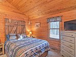 Two travelers will rest comfortably on the queen bed in this first bedroom.