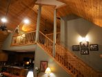 Stairway to Loft Master Suite with private bathroom, granite fireplace with gas log fire