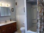 Full bathroom with cast iron bathtub
