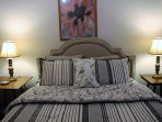 Queen bed with matching lamps