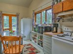 The barn includes a kitchenette and seating.