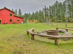 The cabin sits on 10 acres and includes a campground, rec barn, fire pit, and more!