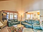 Curl up on one of the couches and watch a movie on the flat-screen TV in the living area.
