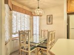 Gather around this glass table with seating for 6, to enjoy delicious home-cooked meals!