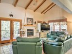 This 3-level townhome features towering ceilings with real wood beams.