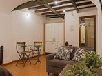 Cozy loft with large bed, kitchenette, sofa and bathroom with shower and washing machine