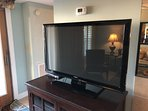 Large TV in living room with two other flat screen TV's in bedrooms.
