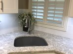 Large granite sink with high-end quartz countertops