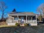 Studio cottage w/charming front porch & peak of bay - in town, steps to harbor!