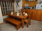 Dining table for 6-8, plus a high chair.  Designed for families.