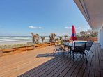 Decking with ocean views, stretches from one side of the back of the house to the next!
