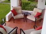 Comfortable seating over looking the pool and gardens from the sun soaked terrace