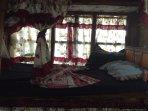 each bed is twin size, & has fan, light, outlet & locker. price includes breakfast & dinner meal.