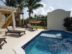 Comfy sunloungers and hammock around the pool