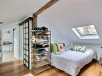 Bedroom 2 is equipped with : Large single bed (1.20m), hard wood floor.you must cross this bedroom t