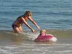 Learning to surf in the safe shallow sea, perfect for that first dip in the warm water
