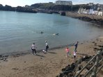 Small sheltered sandy beach at Portpatrick Harbour