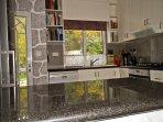 Kitchen: breakfast bar, granite work tops.