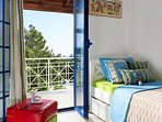 Elegant, with simple lines, plenty of Greek sunlight, spacious and comfortable.