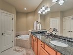 Morning routines will be a breeze in the en-suite bathroom with a double vanity.