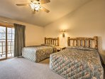 The second bedroom boasts 2 cloud-like queen beds!