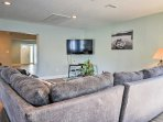 Spend downtime watching shows on the flat-screen cable TV.
