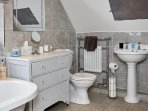 First floor family bathroom with basin, wc, roll top bath & walk in shower cubicle