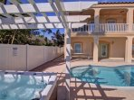 Wow, brand new hot tub with pergola and a huge ,heated pool