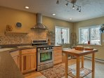 Complete with stainless steel appliances and an expansive counter, this kitchen makes cooking fun and easy.